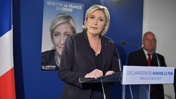 French candidates halt campaigns; Le Pen calls for border controls
